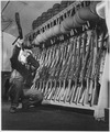 Group 4. Looking over guns in guard room. England, circa 1944. - NARA - 540070.tif