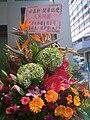 HK Kwun Tong 鱷魚恤中心 Crocodile Centre Ho Choi Group opening flowers.JPG
