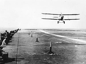 Arresting gear - Fairey III-F aircraft landing on board British Aircraft Carrier HMS Furious circa early 1930s. Arresting gear wires are visible above the flight deck.