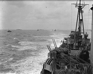 HMS Mauritius (80) - Mauritius with other Allied shipping off the beachhead at Anzio, March 1944