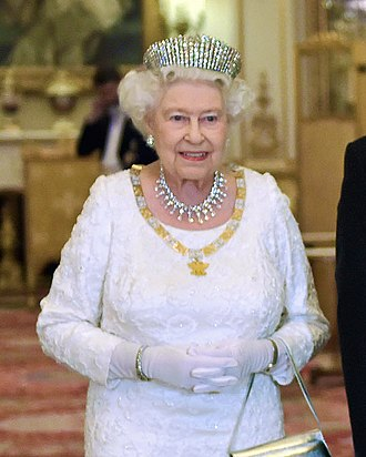 Elizabeth II's jewels - Elizabeth wearing the Kokoshnik Tiara, diamond earrings, a diamond necklace and bracelet, and a silver watch to a state banquet for the President of Mexico in 2015