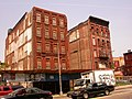 Harlem buildings, 8th ave on 127th st - panoramio.jpg