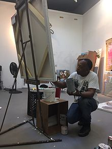Henry Taylor painting in studio.JPG
