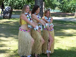 Grass skirt - Three hula girls wearing grass skirts