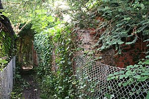 English: Hidden shed Hidden brick shed by the ...