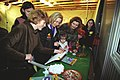 Hillary Rodham Clinton looks at arts and crafts with women and children at Tuzla Air Force Base in Bosnia - Flickr - The Central Intelligence Agency.jpg