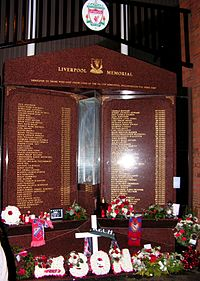 Hillsborough Memorial, which is engraved with the names of the 96 people who died in the Hillsborough disaster. Flowers are below the memorial.