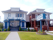 Two two-storey houses with signs marking one as Hitsville U.S.A.