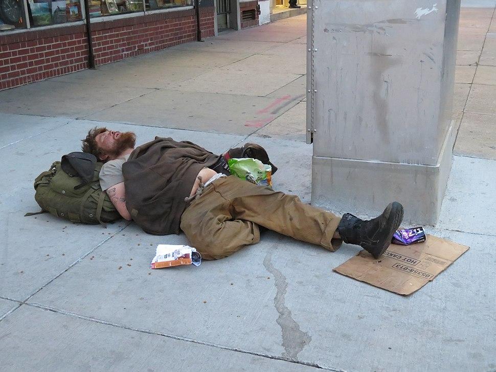Homeless man sleeping on Colfax Street, Denver
