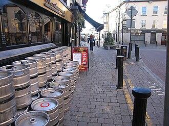 Keg - 88-pint beer kegs lined up outside a pub in Portlaoise, Ireland