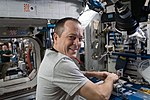 ISS-55 Ricky Arnold works with Genes inside the Harmony module.jpg