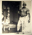 Indian holy man and Hanuman idol in the 1940s.jpg