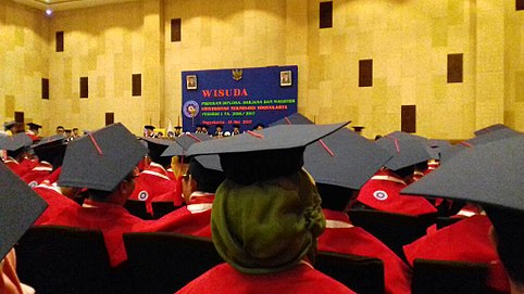 common type of indonesian academic regalia with color coded cape and pentagon cap