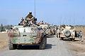 Iraqi BTR-94 next to a Humvee.JPEG