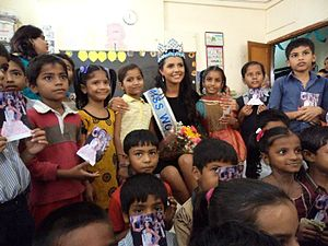 Miss World - Ivian Sarcos in a school in Mumbai, India