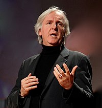 A photograph of Cameron speaking at the 2010 TED conference