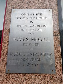 "Wall plaque. Text reads: ""On this site stood the house in which was born in the year 1764 James McGill founder of McGill University Montreal Canada""."
