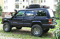 Jeep Cherokee XJ lifted blue Warsaw apartment parking.jpg