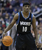 Jonny Flynn, wearing a black headband, dribbling the basketball