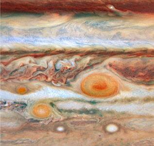 An image taken by the Hubble Space Telescope shows the two more red spots adjacent to the Great Red Spot on the surface of the planet Jupiter. This was previously unknown; until recently when Hubble found this.