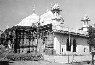 Conversion of non-Islamic places of worship into mosques - The original temple of Kashi Vishwanath with 'Gyanwapi' mosque standing atop.