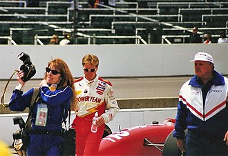 1997 Indianapolis 500 - Davey Hamilton (left) and car owner A. J. Foyt (right) walk through the pit area on Tuesday after the race.