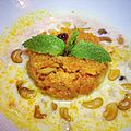 Kheer with carrot (gajar) halwa in the middle, San Francisco 2012.jpg