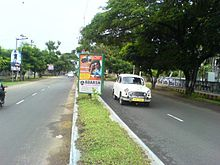 Four-lane road, with narrow grass median