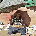 Lady in Madagascar sowing for a living.jpg