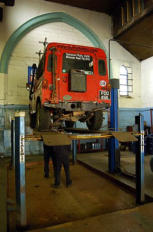MOT test - A Land Rover has its chassis inspected as part of its MOT. The vehicle structure is among many of the points covered in an MOT test.