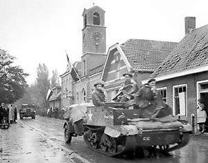 Battle of Walcheren Causeway - Royal Hamilton Light Infantry carriers move through Krabbendijke