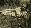 Lithuanian migrant lying on grass (8400354979).jpg