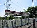 Llanfairpwllgwyngyllgogerychwyrndrobwllllantysiliogogogoch station sign.jpg