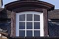 Lucarne cintrée de la façade arrière de l'ancien doyenné (Lisieux, Calvados, France).jpg