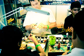 People Painting Games Workshop Miniatures At The Middle East Film And Comic Con 2012