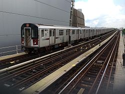 Manhattan bound R142A 4 train enters Yankee Stadium.jpg