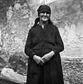 Marija Juriševič, Golac 69 (pri Heričovih), 80 letna, ima na sebi facou (na glavi), lajbac in veštaljo (obleko in krilo skupaj iz celega) 1955.jpg