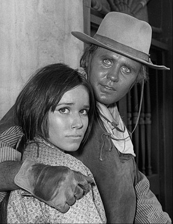 Hershey and Mark Slade in TV western The High Chaparral, 1968) Mark Slade Barbara Hershey High Chaparral 1968.JPG