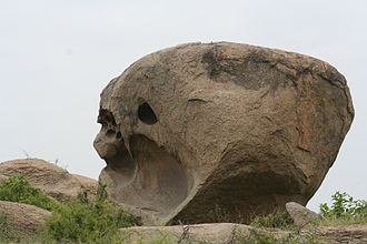 Viratnagar - Natural stone formation in the shape of a massive human skull with an exaggerated brain case.