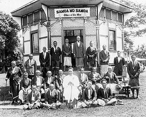 Tupua Tamasese Lealofi III - Tupua Tamasese Lealofi III in front of the octagonal Mau office in Vaimoso village, near Apia, 1929. (Photograph by Alfred John Tattersall)