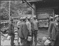 Miners bring in their checks and see the sign that there is no Saturday work. P V & K Coal Company, Clover Gap Mine... - NARA - 541295.tif