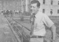 "Missouri State Penitentiary Warden Donald ""D.W."" Wyrick on penitentiary yard. Housing Unit A, built in 1868, in background.tif"