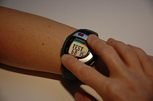 Picture of person taking Heart Rate on MIO watch
