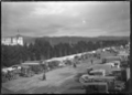 Motor cars and charabancs parked at Trentham Racecourse in 1919. ATLIB 288430.png