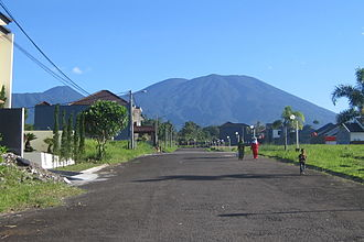 Mount Gede - Mount Gede's southern side seen from Sukabumi Regency. The smaller peak on the left is Mount Pangrango.