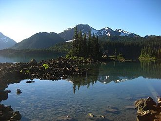Canadian Cascade Arc - Mount Price and one of the Battleship Islands reflected in the clear water of Garibaldi Lake