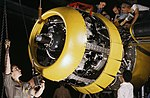 Mounting motor on a Fairfax B-25 bomber, at North American Aviation, Inc., plant in Inglewood, Calif (cropped).jpg