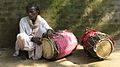 Musician with his two dholaks for festivals.jpg
