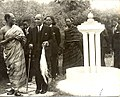Ngwazi and Asantehene stroll with retinue in well laid gardens at the Chiefs residence.jpg