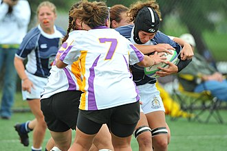 College rugby union in the United States - Penn State vs West Chester University of Pennsylvania (2008). Nichole Lopes '07 '09 with the ball for Penn State